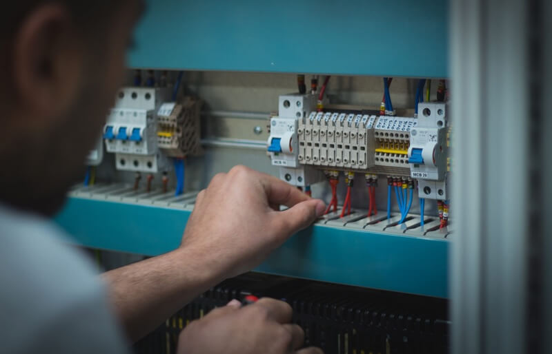 Photo of Lewis Laming working on an electronic circuit board